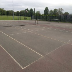 Relining Tennis Surfaces in Abram 6