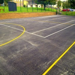 Relining Tennis Surfaces in Abram 1