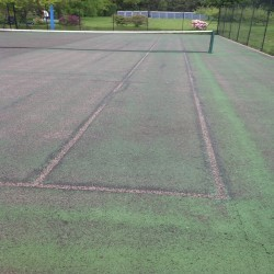 Relining Tennis Surfaces in Abram 5
