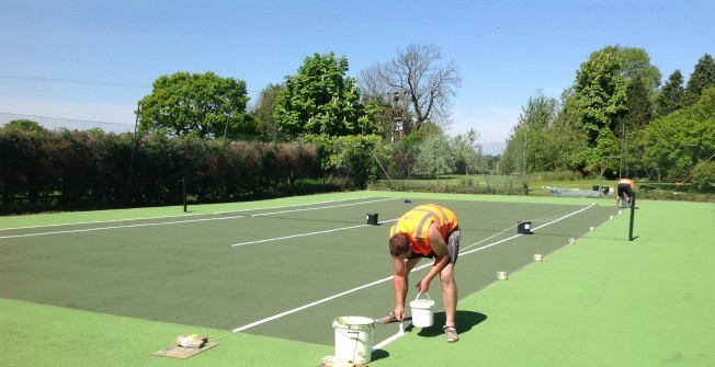 Relining Tennis Surface in Abram